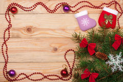 Frame decorated Christmas fir branch on a light wooden background Stock Photos