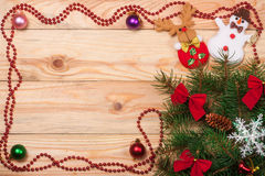 Frame decorated Christmas fir branch on a light wooden background Royalty Free Stock Photos