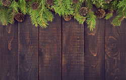 Frame from decorated Christmas tree on rustic wooden background royalty free stock photos