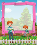 Frame design with father and son in the garden Stock Photography