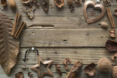 Frame designer of dry leaves and bronze Christmas toys. Frame designer of dry leaves and bronze Christmas toys on a wooden old table Stock Photography