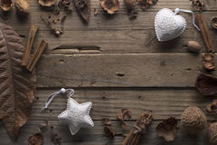 Frame designer of dry leaves and white Christmas toys. Stock Images
