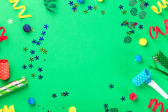Frame from different celebratory items on green background Royalty Free Stock Images