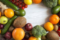 Frame of different fresh organic fruits and vegetables. Top view. Flat lay. Copy space stock photos