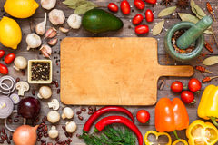 Frame of different fresh organic vegetables and spices on wooden table. Healthy natural food background with copy space. Top view royalty free stock images