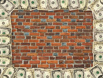 Frame from dollars on the red brick wall Stock Photo