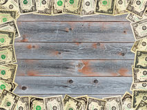 Frame from the dollars on the wooden board Royalty Free Stock Photography