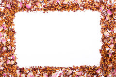 Frame of dried wild rose petals and tea grains on white background, copy space for text Stock Photo
