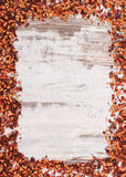Frame of dried wild rose tea grains, copy space for text Stock Photography