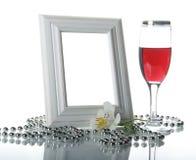 Frame, drinkbeker en orchidee Stock Foto's