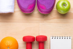 Frame with dumbbells, sneakers and fresh fruits Royalty Free Stock Photo