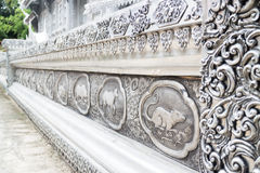Frame engraving silver lacquer of thai lanna zodiac in temple Ch. Frame engraving silver lacquer of thai lanna zodiac in temple is a public place stock images