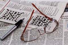Frame Less Eyeglasses on Newspaper Royalty Free Stock Photo