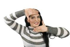 Happy woman framing face Stock Photo