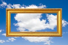 Frame Of Fame. (Blank Golden Picture Frame Against Blue Sky Royalty Free Stock Images
