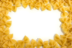 Frame of Farfalle noodles at white background. Frame of Farfalle noodles at white isolated background Stock Photography