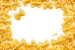 Frame of Farfalle noodles at white background. Frame of Farfalle noodles at white isolated background Royalty Free Stock Images