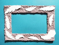Frame with feathers. Paper cutting. Stock Photography