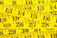 Frame filling yellow measurement tape background Royalty Free Stock Photo