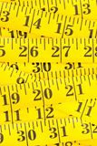 Frame filling yellow measurement tape background stock image