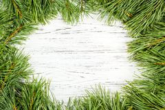 Frame of fir branches with Christmas decorations on old wooden t stock photography