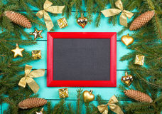 Frame from fir-tree branches and golden toys Royalty Free Stock Images