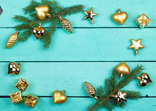 Frame from fir-tree branches and golden toys Stock Images