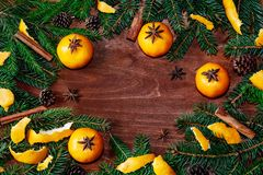 Frame with fir tree branches, tangerines, cones, cinnamon and an Royalty Free Stock Images