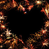Frame of fireworks. Fireworks frame on black background in heart shape royalty free stock photos