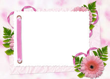 Frame with flower on the pink background. White frame with flower and ribbons on the pink background Royalty Free Stock Photos
