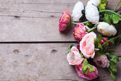 Frame from flowers  on aged  wooden background. Stock Images