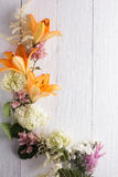 Frame of flowers, background white boards Royalty Free Stock Image