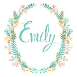 Frame of flowers and ferns with girl`s name Emily Stock Images