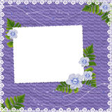 Frame with flowers on the lilac background. White frame with flowers and plants on the lilac background Stock Photography