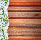 Frame of flowers on wooden background Royalty Free Stock Photos