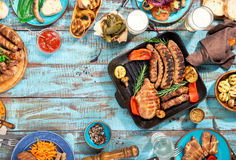Frame of food grilled on wooden table on sunny day Stock Photos