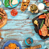 Frame of food grilled on wooden table on sunny day Stock Images