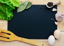 The frame of the foods inside a black background for an inscription. Royalty Free Stock Images