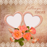 The frame in the form of heart with roses on vintage background Royalty Free Stock Photography