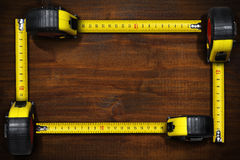 Frame with Four Tape Measures Stock Images