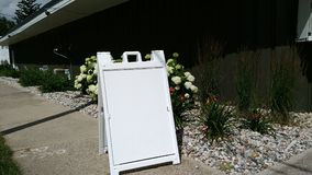 A-FRAME A frame signs image sidewalk yard sandwich board stock image blank. Blank a frame sign took outside of the business good for any stock proofs or Royalty Free Stock Photography