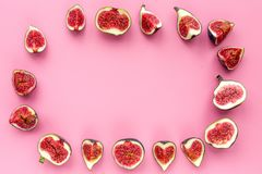 Frame of fresh blue figs slices on pink background top view copyspace Stock Images
