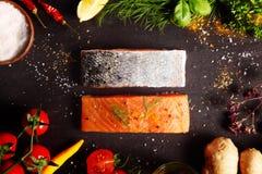 Frame of fresh ingredient with raw salmon steaks Stock Photos