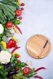 Frame of fresh organic vegetables on a gray concrete background . Healthy natural food top view, copy space. Bok choy pepper cabbage greens artichoke zucchini stock photography