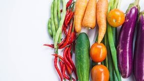 Frame with fresh organic vegetables from Indonesia on white background. Purple eggplant, tomatoes, leeks, carrots, cucumber, chili and beans royalty free stock image