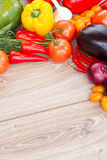 Frame of  fresh ripe of vegetables. Blank wooden table  with frame of  fresh ripe colorful vegetables Royalty Free Stock Photography
