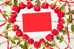 Frame of fresh roses with empty card Stock Photos