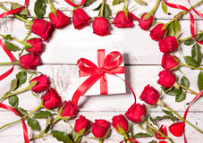 Frame of fresh roses with a gift box Stock Photography