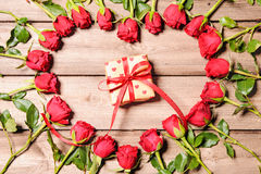 Frame of fresh roses with a gift box Stock Image