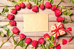 Frame of fresh roses with a gift box Stock Photo